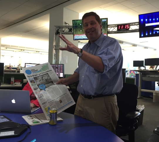 Editor in Chief David Callaway with print paper of bio lab story