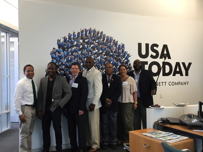 The Back in the Newsroom Fellows visiting USA Today. That's USA Today's Brent Jones, second from left.